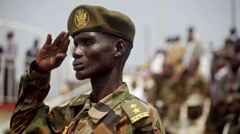 A Southern Sudanese soldier stands at attention during the national anthem during an independence rehearsal procession in Juba, southern Sudan on July 7, 2011. The Government of Southern Sudan is making lavish preparations to celebrate its independence from the north on Saturday, July 9th.