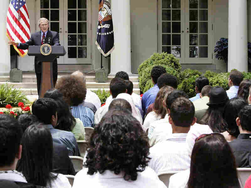Former President George W. Bush speaks to student from the Youth Exchange and Study program at the White House in 2005. The program began in 2004 and ended for Afghan students this year after half of those enrolled fled to Canada.