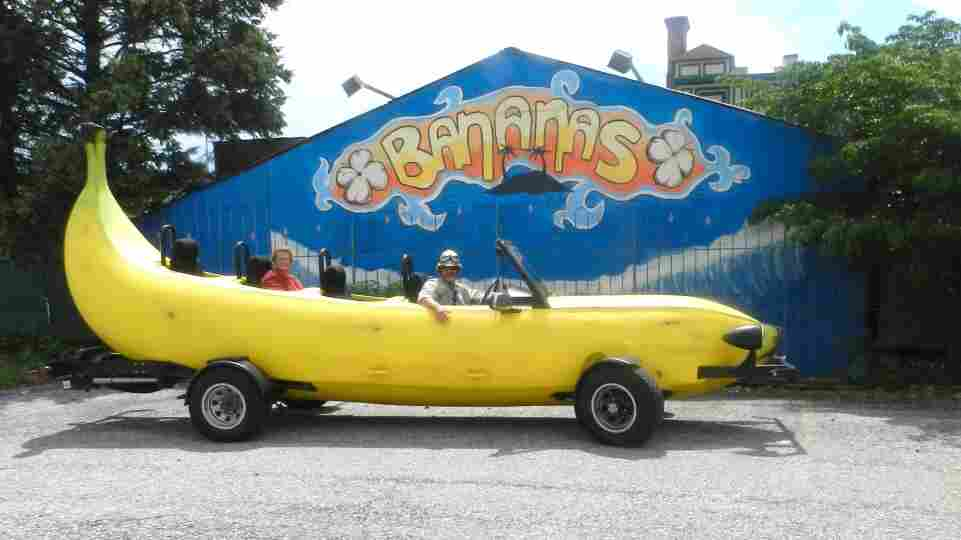 Steve Braithwaite sits in the driver's seat of his Big Banana Car in front of a closed nightclub in Allentown, Pa.