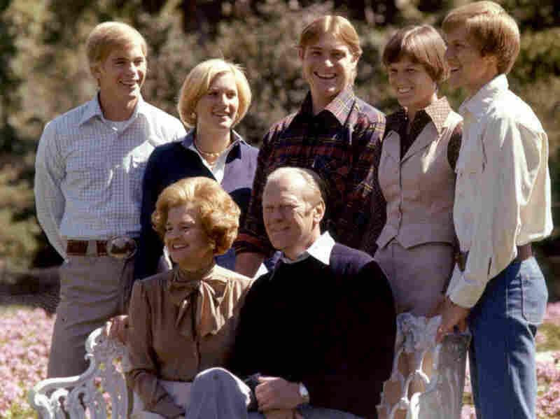 Members of the Ford family pose on the White House grounds in this undated photo. From left, standing: Son Steve; daughter Susan; son Jack; son Michael's wife, Gayle; and Michael. Seated in front: President Gerald and first lady Betty Ford.