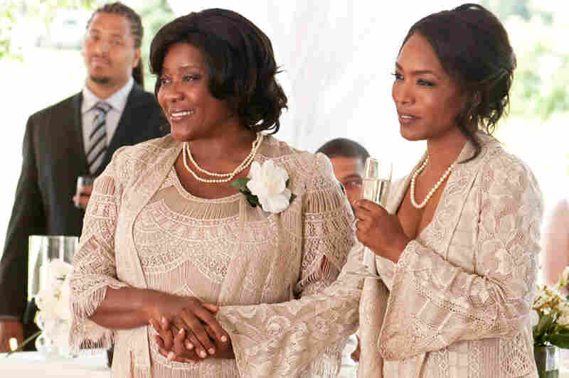 This year, Bassett has had roles in Jumping the Broom (right, with Loretta Devine) and Green Lantern. Credit: Jonathan Wenk/TriStar Pictures