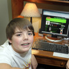 With help from adults, Zachary Swauger, 12 (left), and his brother Joshua, 9, launched their own parent-monitored social networking site for preteens.