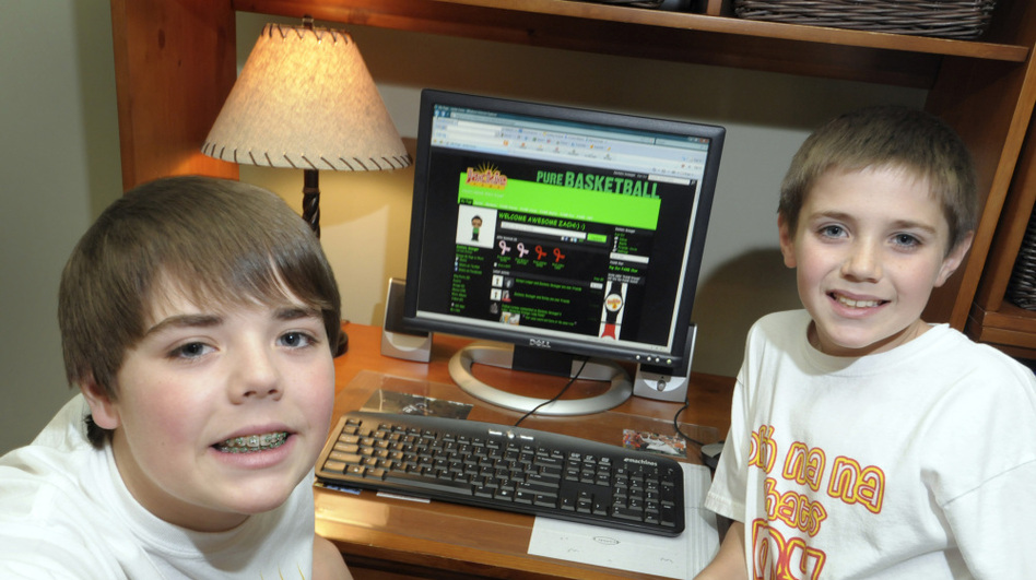 With help from adults, Zachary Swauger, 12 (left), and his brother Joshua, 9, launched their own parent-monitored social networking site for preteens. (Jeff Willhelm/Getty Images)