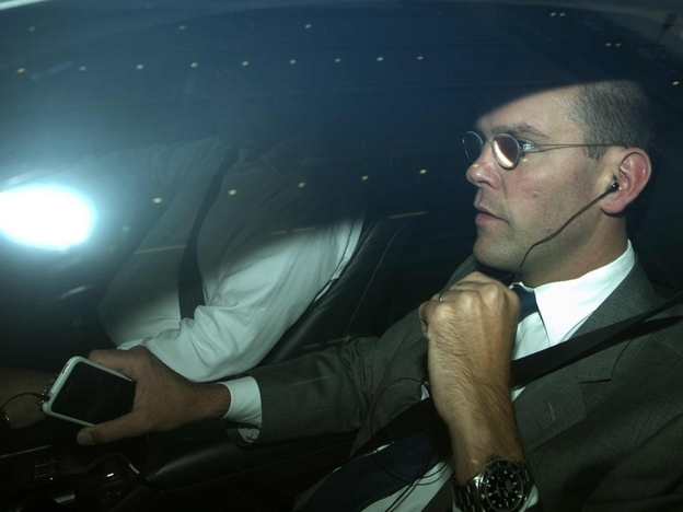 James Murdoch, chairman and chief executive of News Corp. Europe and Asia, is driven away from the offices of News International in London on Thursday. Murdoch announced that the company is folding Britain's best-selling tabloid <em>News of the World </em>amid a phone-hacking scandal. The 168-year-old weekly newspaper will publish its last edition Sunday.