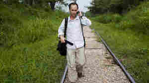 NPR reporter Jason Beaubien walks on railroad tracks while reporting a story about the dangers that face Central American migrants in Tenosique, Tabasco, Mexico.