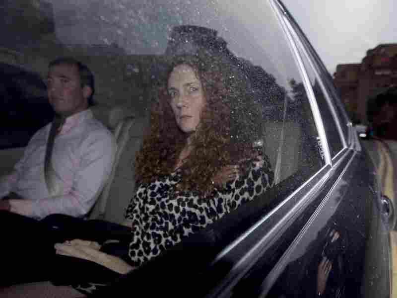 Rebekah Brooks, chief executive of News International, is driven away from her office in London on Thursday. That's the day the company announced it is shutting down News of the World, which is the best-selling tabloid at the center of Britain's phone-hacking scandal. The 168-year-old weekly newspaper will publish its last edition Sunday.