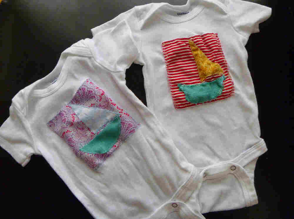 Sailboat onesies made by Emily Grace Whebbe. She is still searching for a name for her soon-to-be-born daughter.