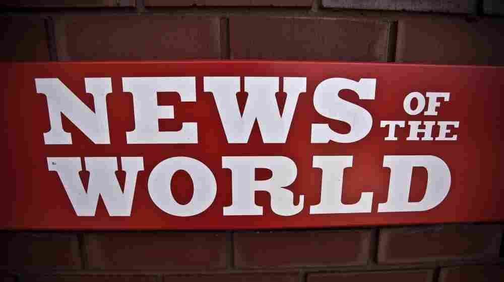 A News of the World sign is posted by an entrance of its parent company in London. News Corp. executive James Murdoch announced Thursday that News of the World will publish its last issue Sunday. A phone-hacking scandal has cost the weekly paper prestige and prompted dozens of companies to pull their ads.