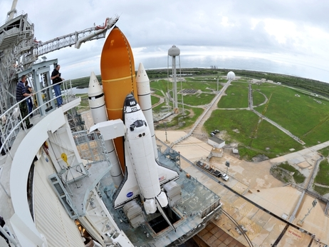 Space shuttle Atlantis waits on the launch pad.