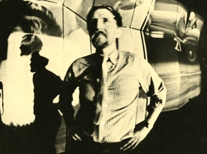 Stan VanDerBeek in front of Movie Mural. Installation view, Institute of  Contemporary Art, Boston, circa 1968