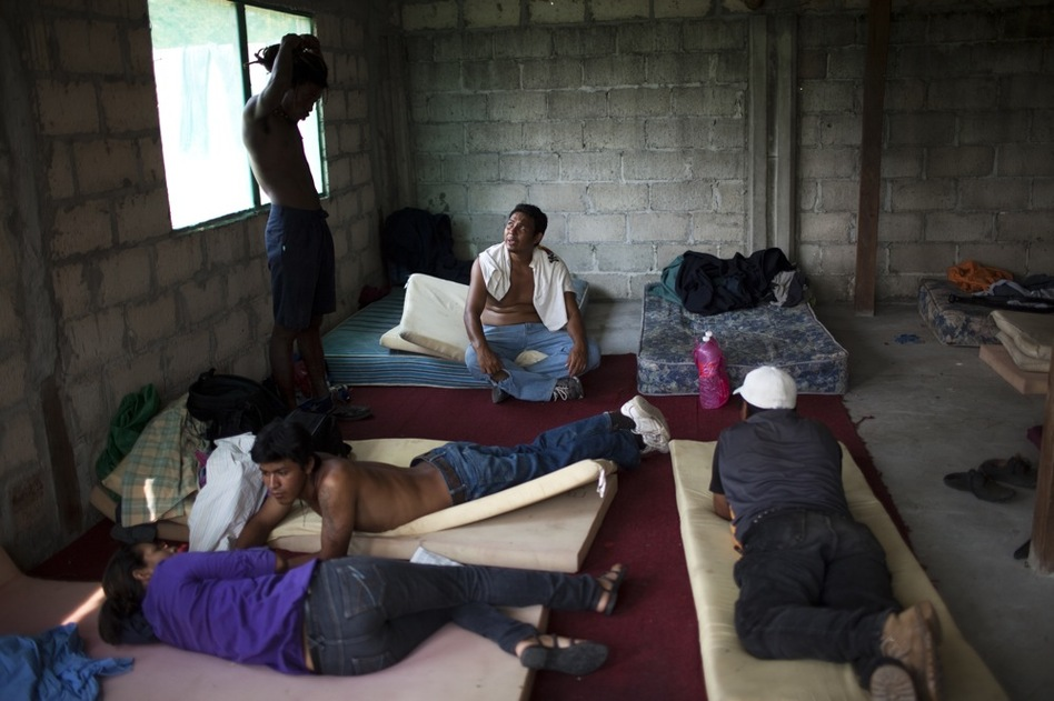 Migrants relax in a shelter in Tenosique, the starting point for many Central American migrants who will travel through Mexico on top of freight trains. (David Rochkind for NPR)