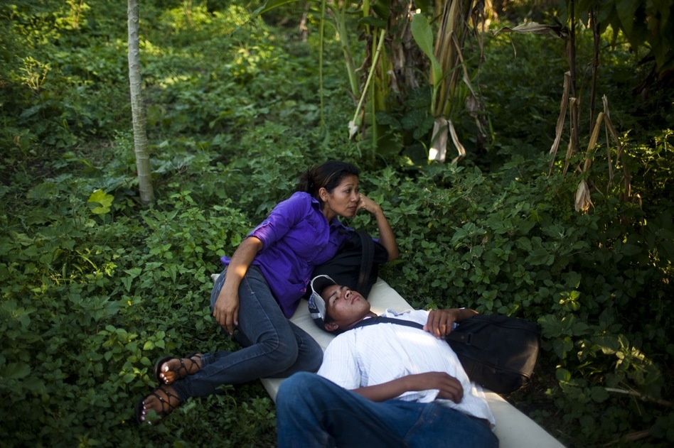 The trip for these migrants has become increasingly dangerous over the past several years as Mexico's drug war has raged, and kidnappings and killings of migrants have increased. Ana Ruiz, a mother of three from El Salvador, says she's making the journey to try to improve the lives of her children. (David Rochkind for NPR)
