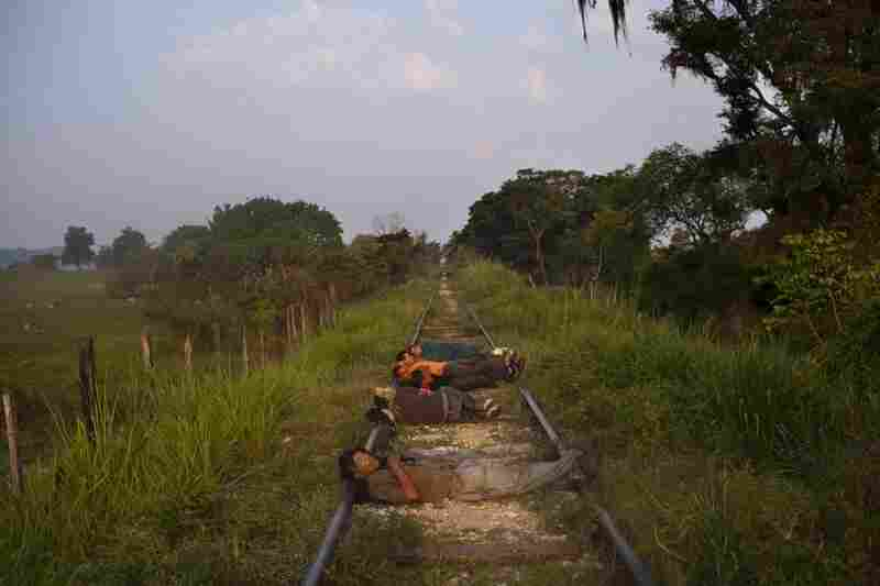 Migrants sleep with their heads on the tracks so they can feel an approaching train and make sure they don't miss it.