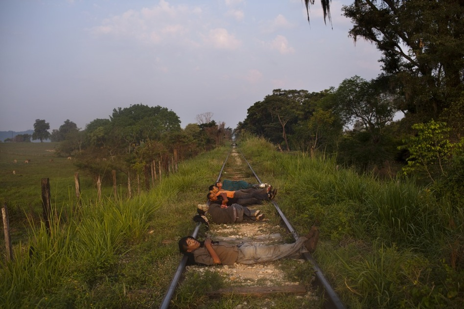 Migrants sleep with their heads on the tracks so they can feel an approaching train and make sure they don't miss it. (David Rochkind for NPR)