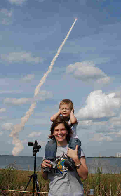 STS-122, Atlantis, Feb., 2008:After a 20-hour drive from Houston to the Kennedy Space Center we were rewarded with an unforgettable experience. When Atlantis took off my wife put our son on her shoulders so that he could see better. I was snapping pictures without looking through the viewfinder as I didn't want to experience this event solely through the viewfinder. We were all fascinate...