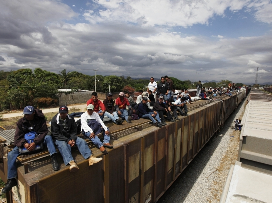 Migrants ride on top of a northern bound train toward the U.S.-Mexico border in Oaxaca, southern Mexico, in March. Migrants crossing Mexico to get to the U.S. have increasingly become targets of criminal gangs who kidnap them to obtain ransom money.