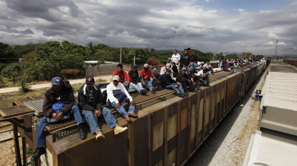 Migrants ride on top of a northern bound train toward the U.S.-Mexico border in Oaxaca, southern Mexico, in March. Migrants crossing Mexico to get to the U.S. have increasingly become targets of criminal gangs who kidnap them to obtain ransom money. (AP)