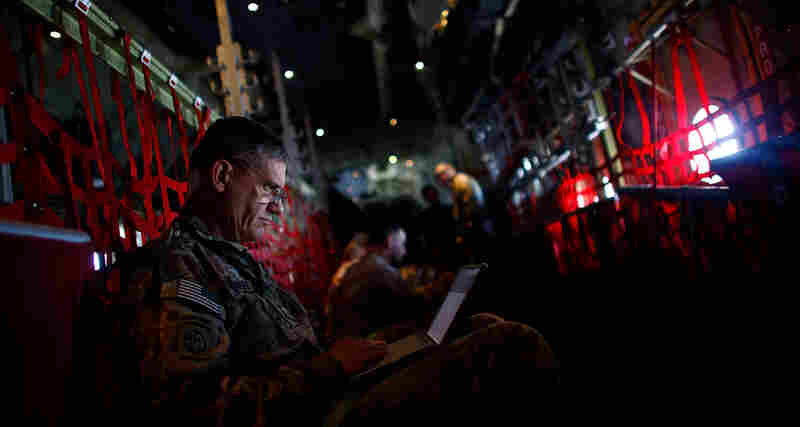 Rodriguez aboard an Air Force C-130 en route to visit Marines in southern Afghanistan. Just a few days prior, Obama announced that 10,000 American troops would come home this year.