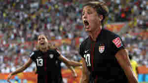 Abby Wambach of Team USA celebrates after scoring her team's equalizing goal during the FIFA Women's World Cup 2011 Quarter Final match between Brazil and USA in Dresden, Germany, on Sunday (July 10, 2011).
