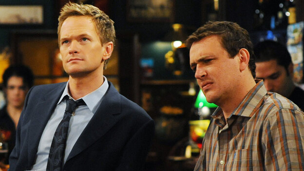 Neil Patrick Harris and Jason Segel appear in this (unaltered) image of an episode of How I Met Your Mother. If you saw it as a rerun, perhaps right over their heads, there would be a great big TV advertising a new film. Look at all the blank space!