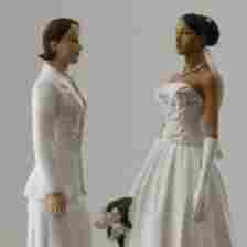 Two female figurines stand atop a wedding cake on display in a New York bakery. Lesbian couples are twice as likely to marry as gay couples, UCLA demographer Gary Gates says.
