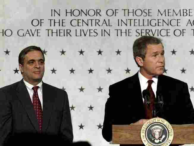 President Bush (right) addresses employees of the Central Intelligence Agency as CIA director George J. Tenet looks on in March 2001.  Under Tenet's leadership, the CIA would develop its role in the war on terrorism after the September 11, 2001, attacks.