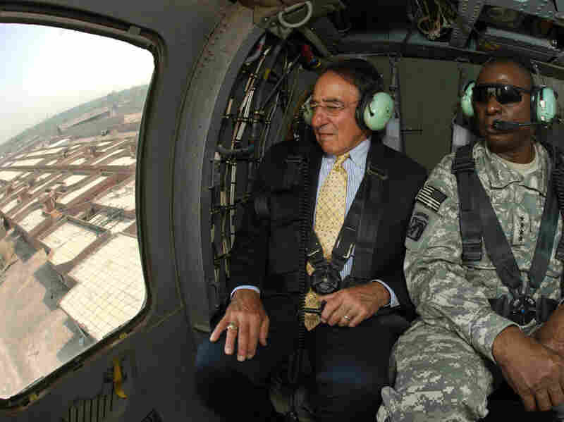 Secretary of Defense Leon Panetta sits with Gen. Lloyd Austin, the top U.S. commander in Iraq,  as they fly in a Black Hawk helicopter over Baghdad on Monday.