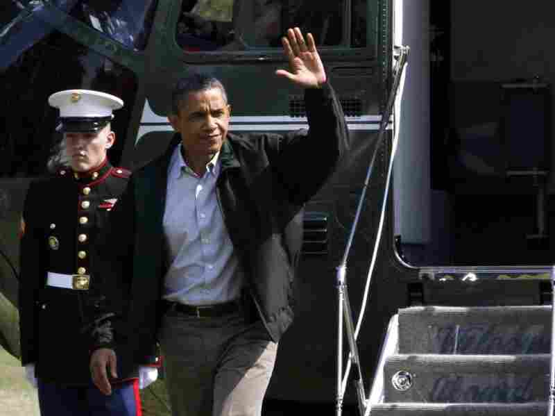 President Barack Obama waves as he exits Marine One on return from Camp David on the South Lawn of the White House in Washington, on Sunday, July 10, 2011.