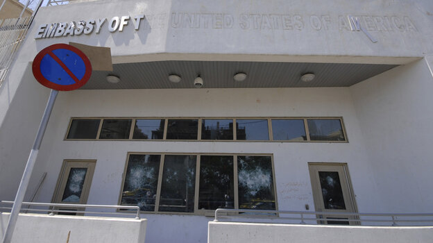 The damaged front side of the U.S. embassy is seen after pro-government protesters attacked the