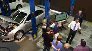 President Obama tours the Automotive Training Program at the Northern Virginia Community College, Alexandria campus, in June, Va. Slower economic growth means fewer opportunities for U.S. companies, which in turn leads to less hiring.