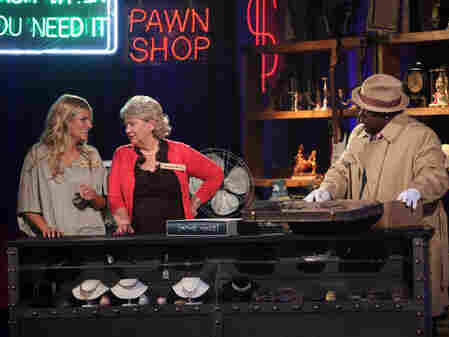 "In It's Worth What? host Cedric ""The Entertainer"" asks contestants to guess at the prices of found objects."