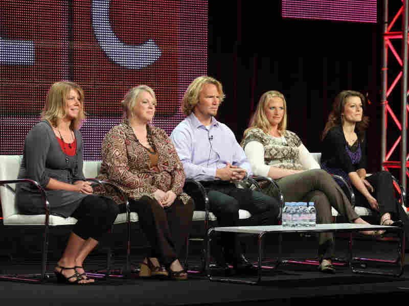 Last summer, members of the Brown family — Meri (from left), Janelle, Kody, Christine and Robyn — spoke to the media as they prepared for the debut of their reality TV show, Sister Wives.