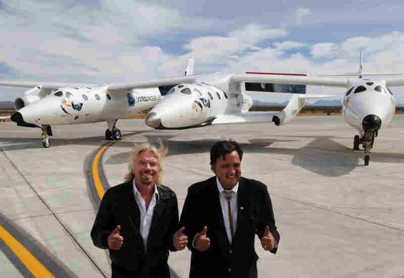 In the future, people will be carried into space by private-sector projects like the Virgin Galactic VSS Enterprise, says former astronaut Jeffrey Hoffman. Here, the Enterprise sits behind Virgin boss Richard Branson, left, and New Mexico Gov. Bill Richardson.