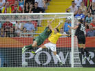 U.S. forward Abby Wambach heads in the equalizer past Brazil's defender Daiane and goalkeeper Andreia Sunday in Dresden.