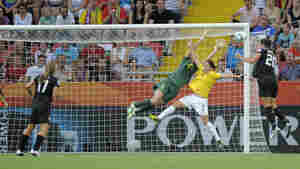 U.S. forward Abby Wambach heads in the equalizer past Brazil'