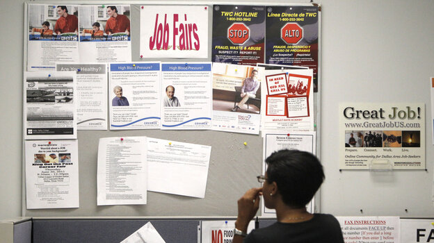 A job seeker looks at a bulletin at the Texas Workforce Commission's Workforce Solutions of Greater Dallas job resource center in Richardson, Texas, Tuesday, July 5, 2011.