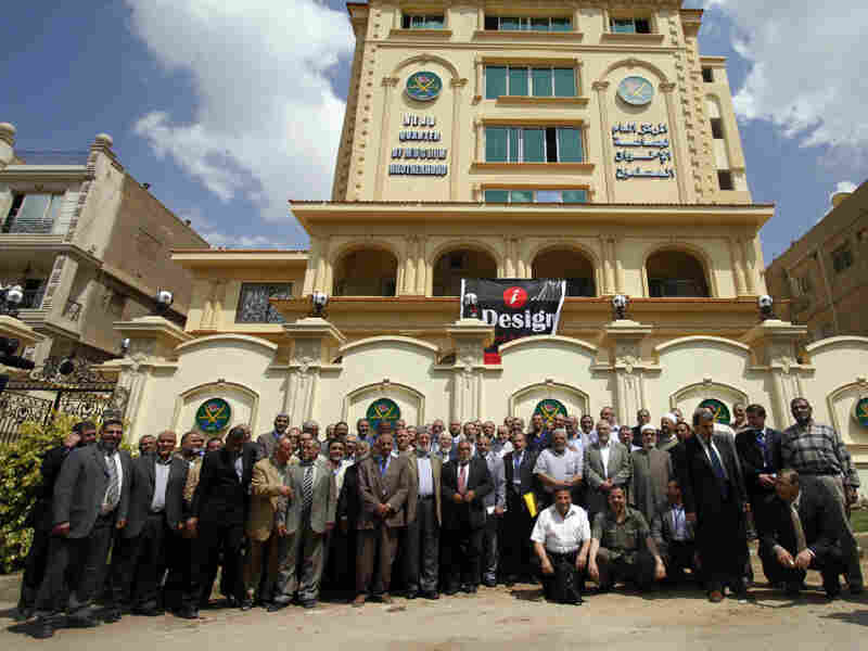 Egyptian Muslim Brotherhood Shura council members gather outside the new Muslim Brotherhood headquarters in Cairo on April 30.