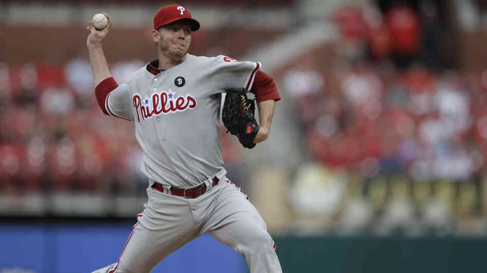 Philadelphia Phillies starting pitcher Roy Halladay throws during the first inning against the St. Louis Cardinals in June 2011. He will be the National League starter at Tuesday night's All-Star Game.