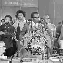 Mayor Richard Hatcher of Gary, Ind., addresses the press at the opening of the National Black Political Convention, March 10, 1972.  Rev. Jesse Jackson is second from left.