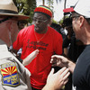 A police officer (left) tries to keep the peace as immigrant rights protester Bobby DeVeaux (middle) and Tea Party supporter David Jones argue amid 450 immigrant rights protesters marching on the Arizona Capitol last spring.