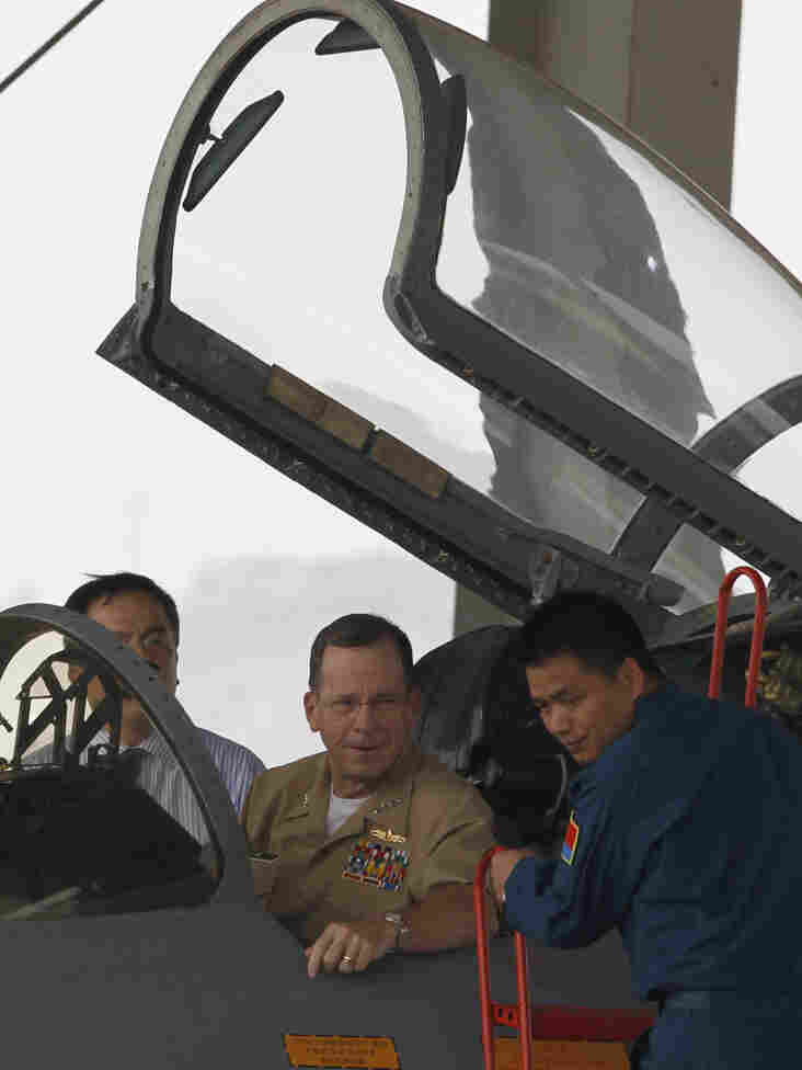 Adm. Mike Mullen sits in the cockpit of an Su-27 fighter jet at the Division 19 Aviation PLA Air Force base in Jining on Tuesday.