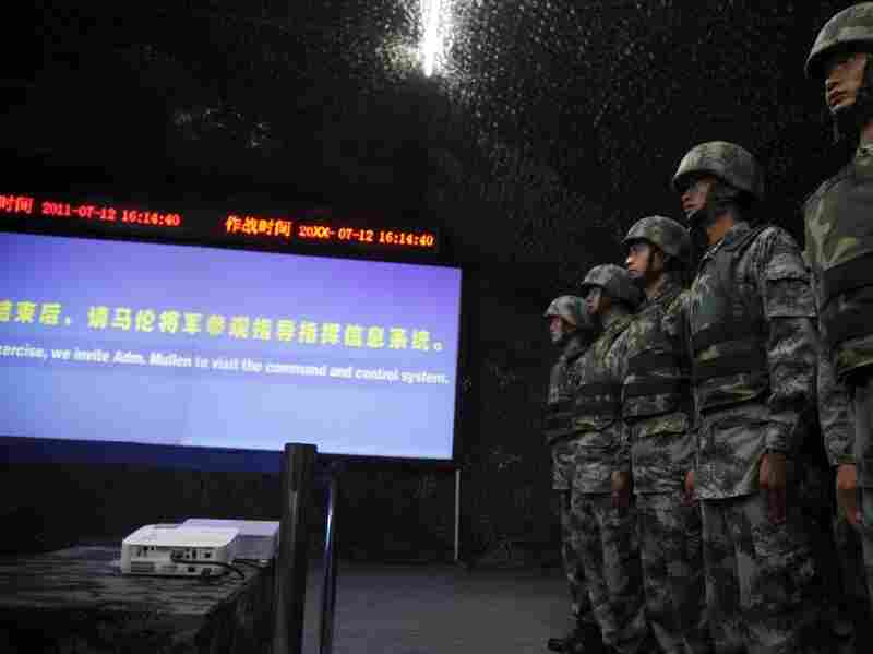 Chinese military officers prepare to take part in a mock operation for Adm. Mike Mullen at an exercise headquarters of the 1st Mechanized Infantry Division of the People's Liberation Army in Hangzhou on Tuesday.