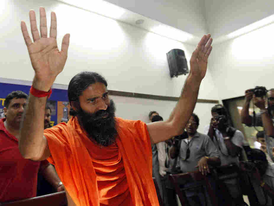 Guru Baba Ramdev's anti-corruption protests helped draw the attention of the government, which then began looking into his financial holdings. Here, he arrives at a media conference in New Delhi, June 26, 2011.