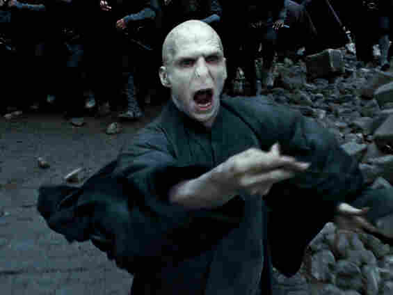 Ralph Fiennes flexes his lizard wizard tongue one last time as the evil Lord Voldemort.