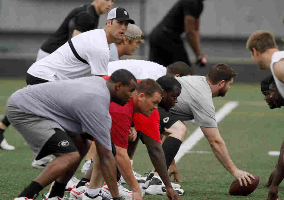 Not A Snickers Commercial: Kansas City quarterback Matt Cassel lines up behind center Rudy Niswanger as players take part in an informal workout. The NFL has been locked in talks between labor and management this summer.