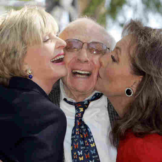 Writer/producer Sherwood Schwartz receives a kiss from actresses Florence Henderson, left, and Dawn Wells during a 2008 ceremony where Schwartz was honored with a star on the Hollywood Walk of Fame in Los Angeles.
