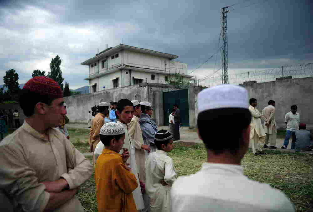 Pakistanis gather in front of the compound where Al-Qaida chief Osama bin Laden was killed in Abbottabad.