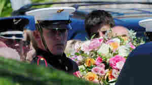 A military honor guard carries the casket of former first lady Betty Ford, wife of former President Gerald Ford, from the hearse to the entrance of St. Margaret's Episcopal Church in Palm Desert, Calif., for a private memorial service Tuesday.