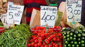 Even in Italy, healthy peasant fare like the fresh vegetables and fruits at this market stall in Venice isn't cheap, leading many there to abandon the famously healthy Mediterranean diet.