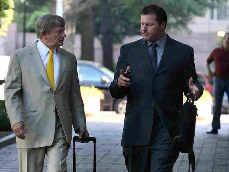 Baseball pitching star Roger Clemens (right) walks with his attorney, Rusty Hardin, as he arrives at the U.S. District Court for the start of his perjury trial on Wednesday in Washington, D.C.
